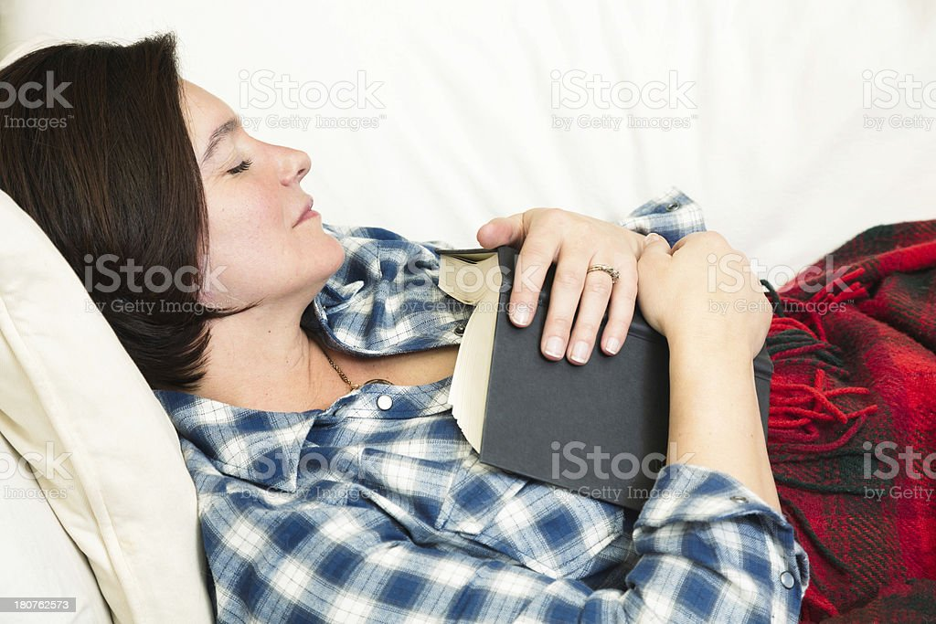 Woman sleeping holding a book profile horizontal royalty-free stock photo