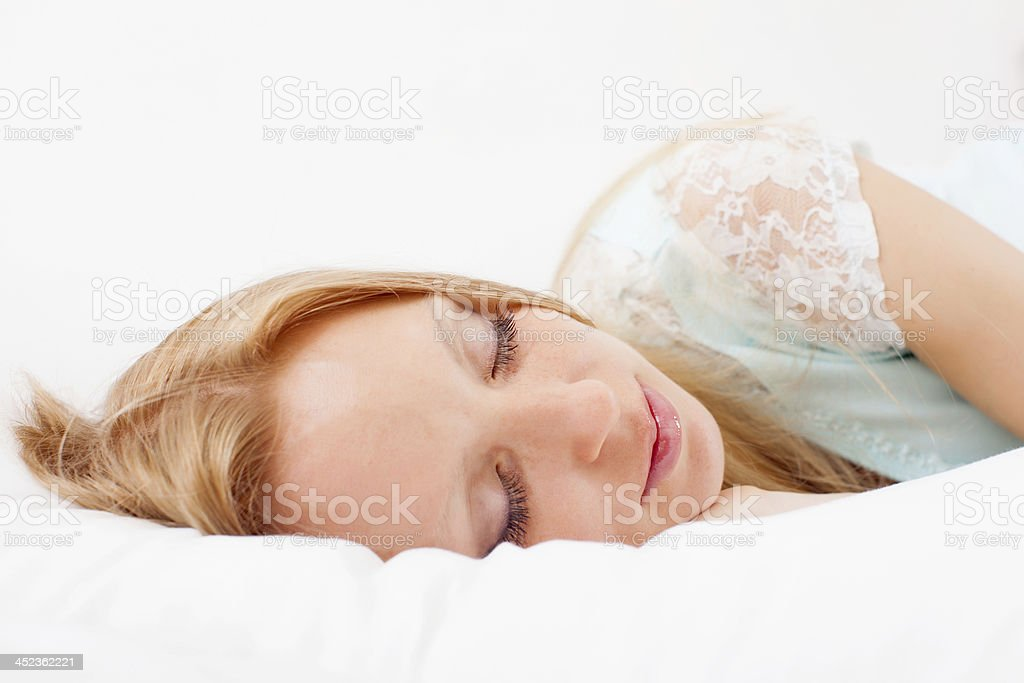 woman sleeping in bed royalty-free stock photo