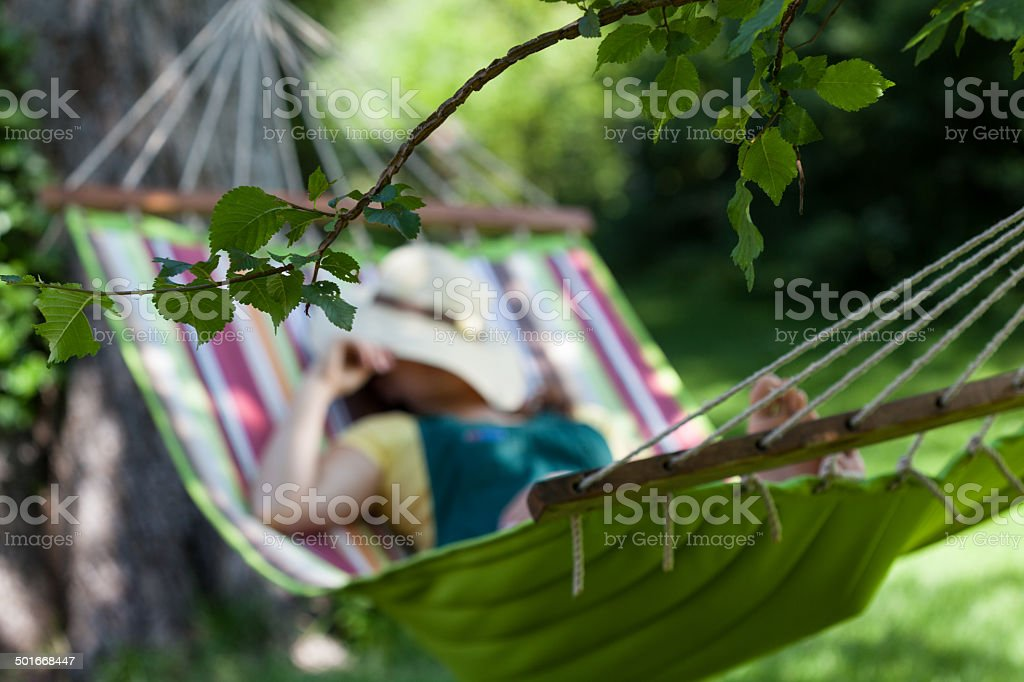 Woman sleeping on a hammock stock photo
