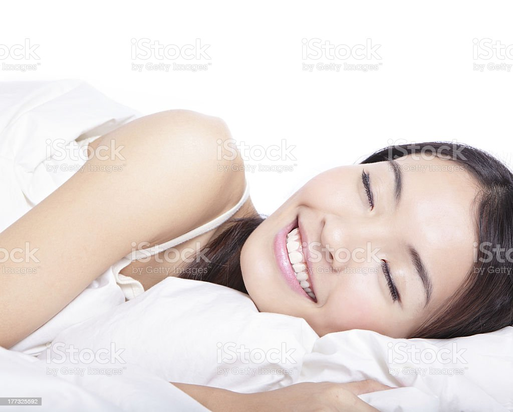 Woman sleeping on bed in the morning stock photo