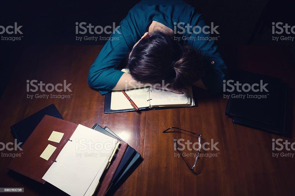 Woman Sleeping On Desk stock photo