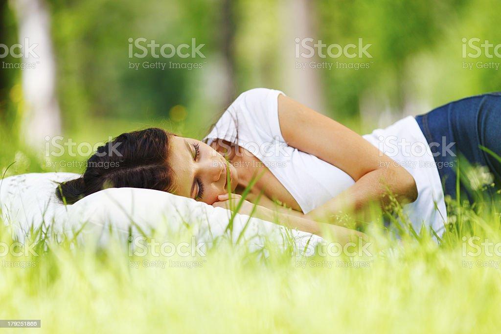 Woman sleeping on grass royalty-free stock photo