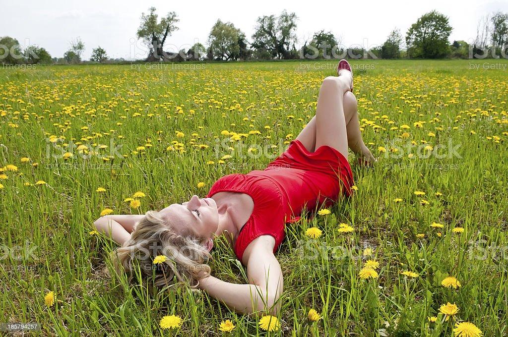 woman sleeping on meadow stock photo