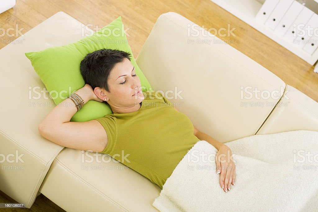 Woman sleeping on sofa royalty-free stock photo