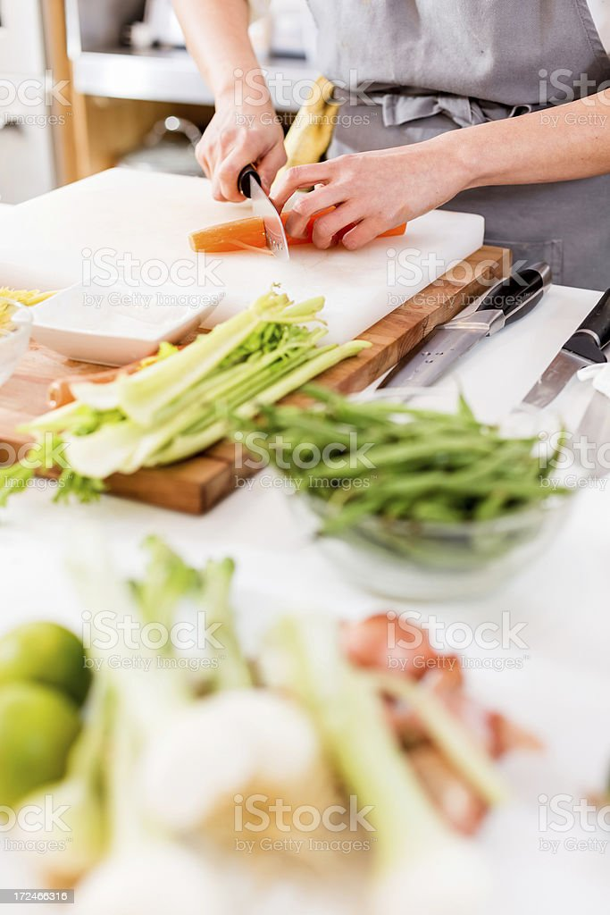 Woman Slicing carrots royalty-free stock photo
