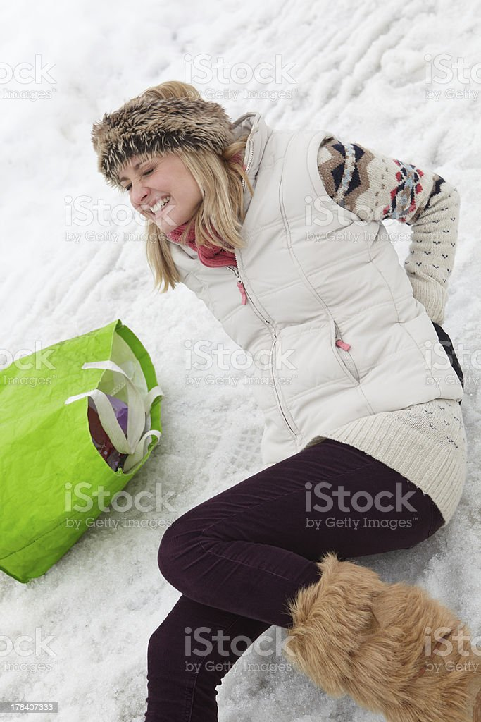 Woman Slipped And Injured Back On Icy Street stock photo