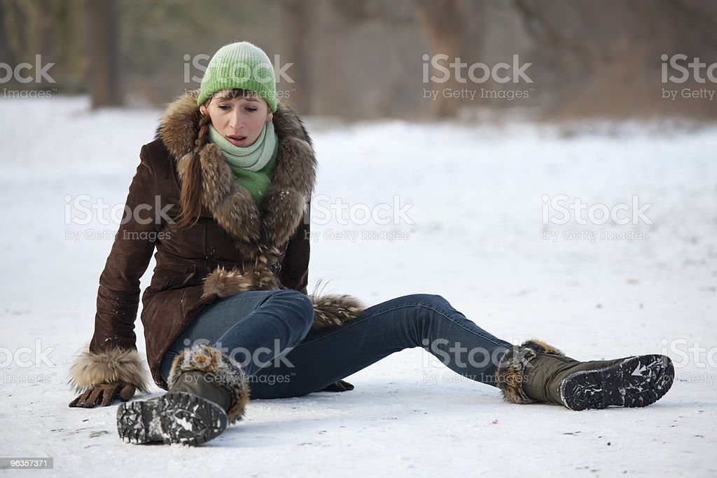 woman slips on snowy road stock photo