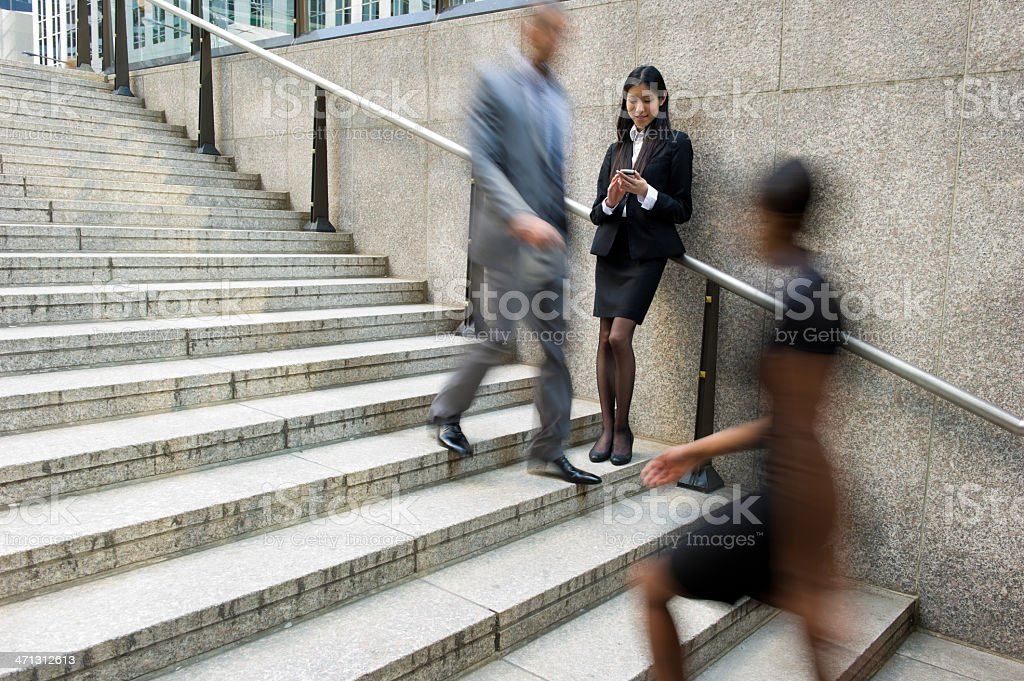 Woman slowing down to look at messages in fast paced world royalty-free stock photo