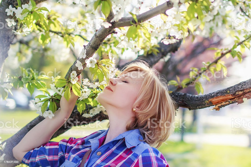 Woman smell flower from tree royalty-free stock photo