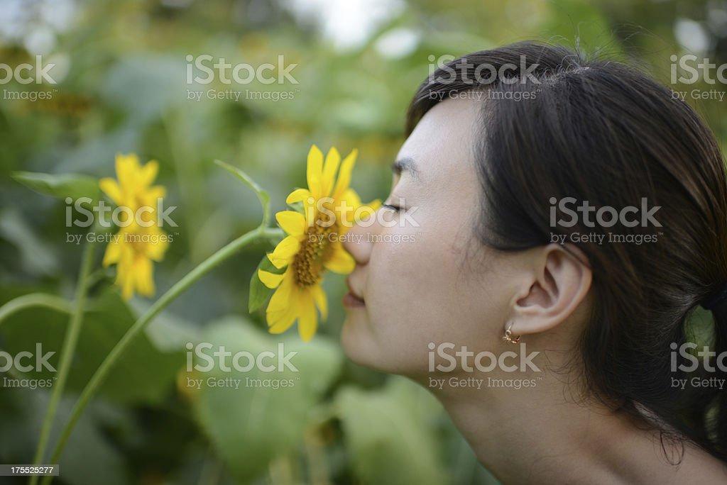 Woman Smell Flower - XXXXXLarge stock photo