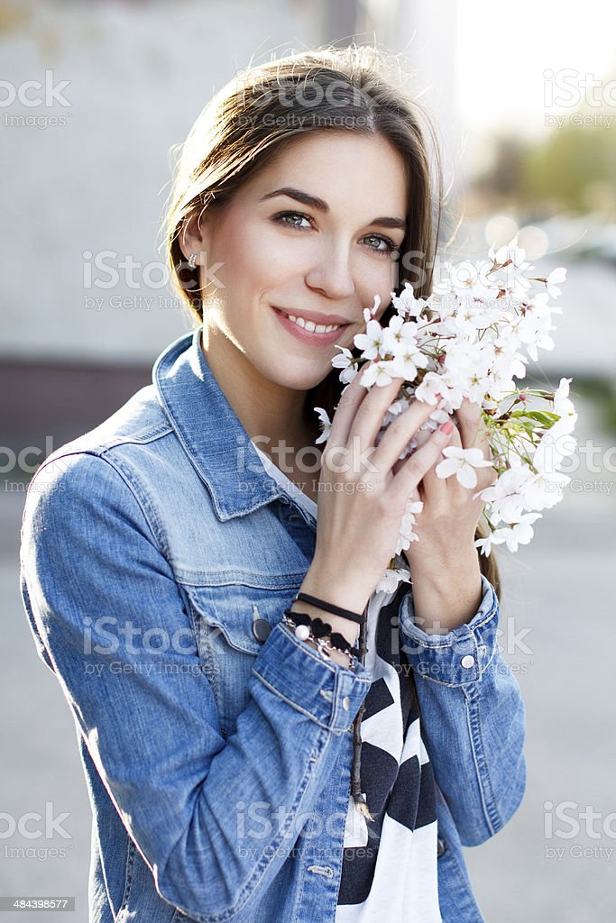 Woman smelling cherry tree flower royalty-free stock photo