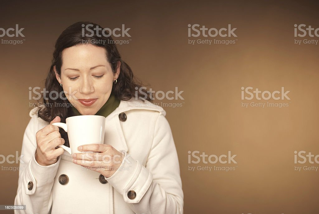 Woman Smelling Coffee royalty-free stock photo