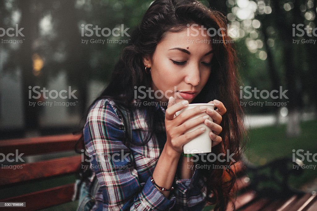 Woman smelling coffee stock photo