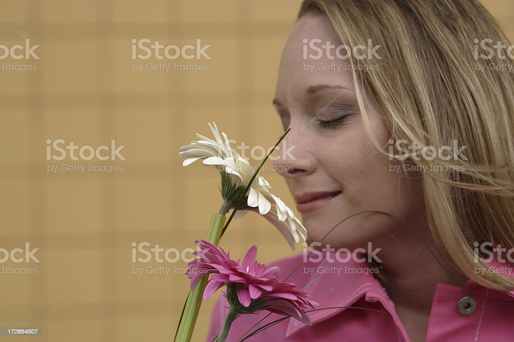 Woman smelling flowers stock photo