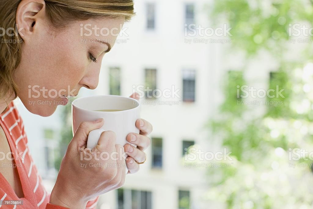 Woman smelling herbal tea royalty-free stock photo