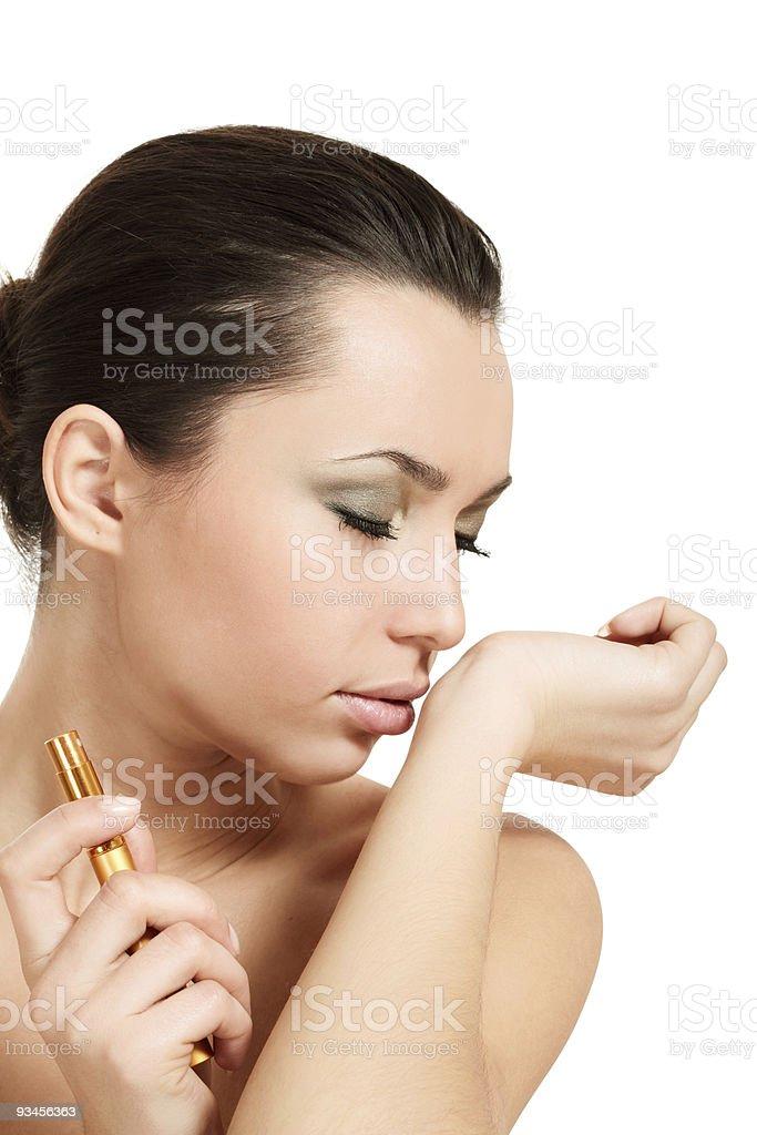 woman smelling parfume royalty-free stock photo