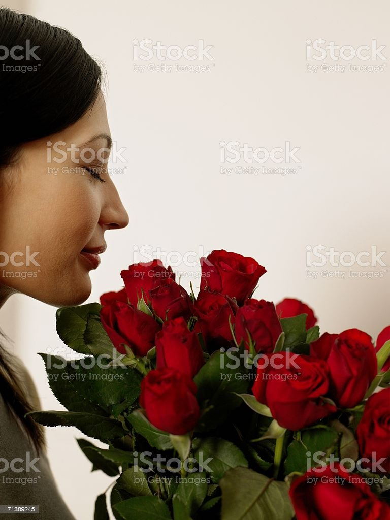Woman smelling roses stock photo