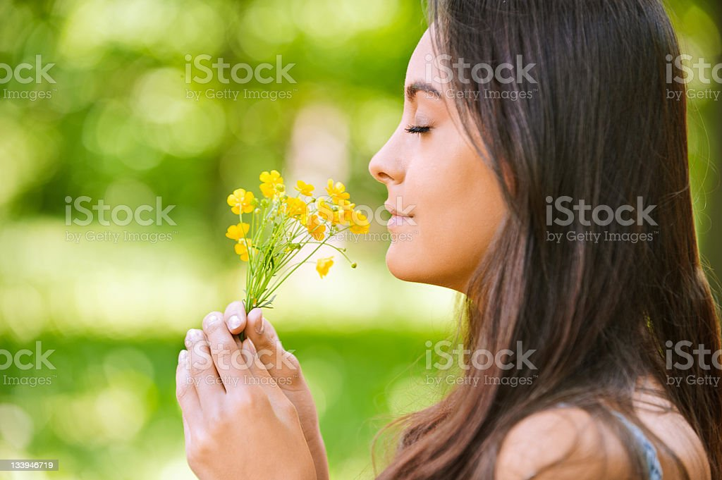 Woman smells yellow florets royalty-free stock photo