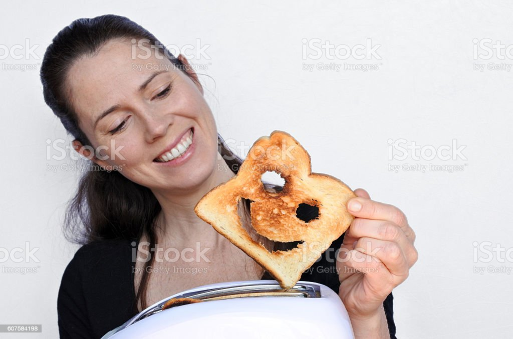 Woman smile and holds a good slice of toast stock photo