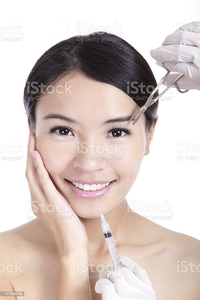 woman smile receiving a injection in her lip royalty-free stock photo
