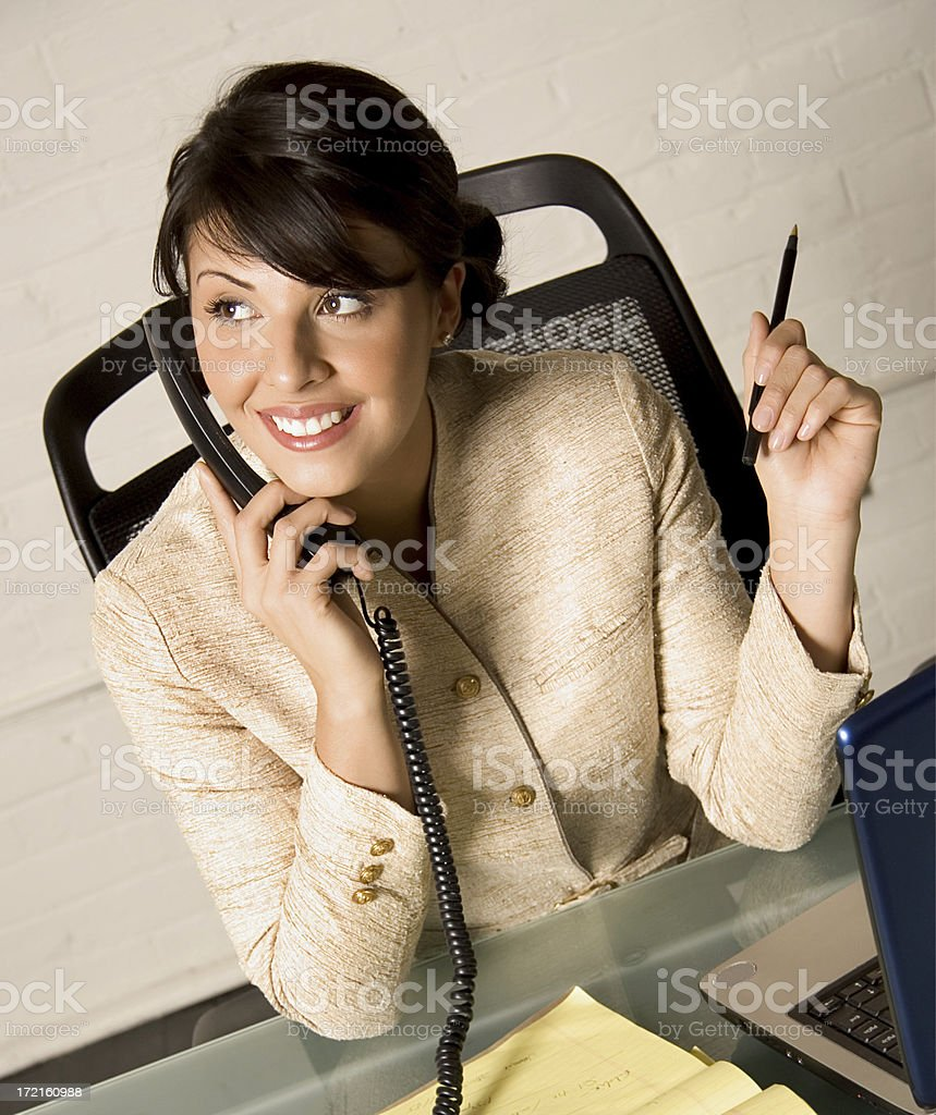 Woman smiles at office royalty-free stock photo