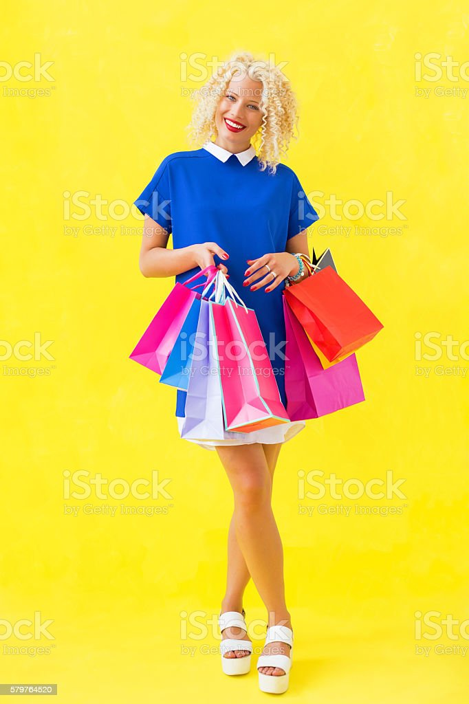 Woman smiling after shopping stock photo
