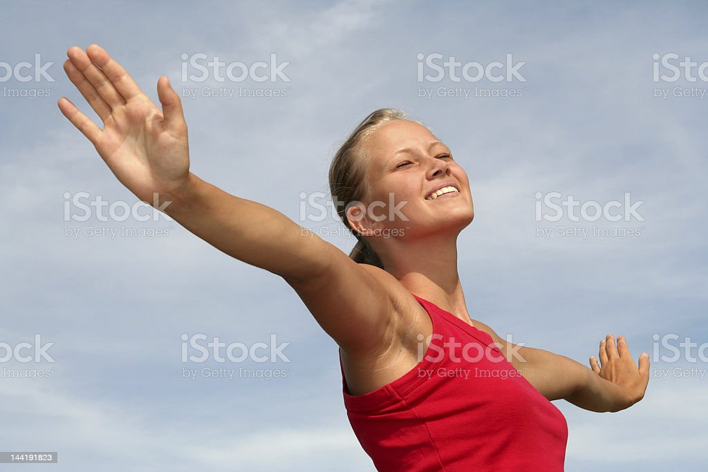 Woman smiling and stretching out her arms royalty-free stock photo