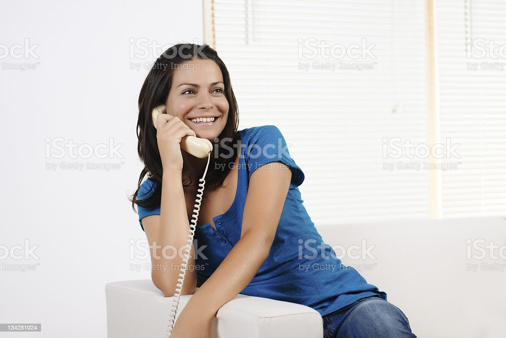 woman  smiling and talking on the phone stock photo