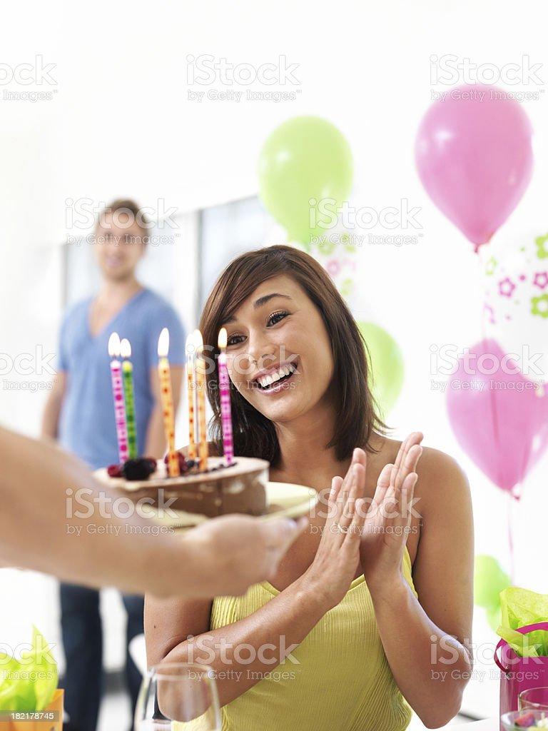 Woman smiling at birthday cake royalty-free stock photo