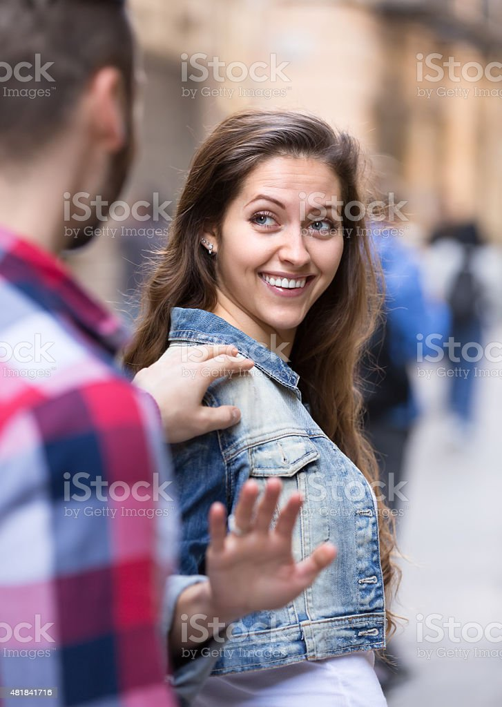 Woman smiling back to a man stock photo