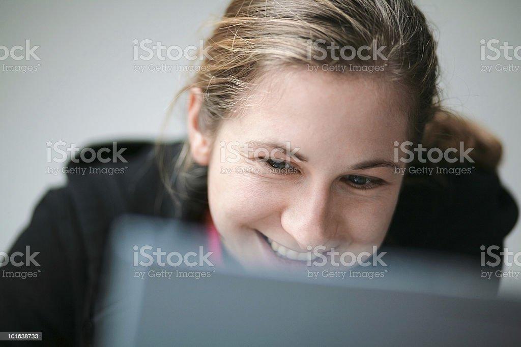 woman smiling behind laptop royalty-free stock photo