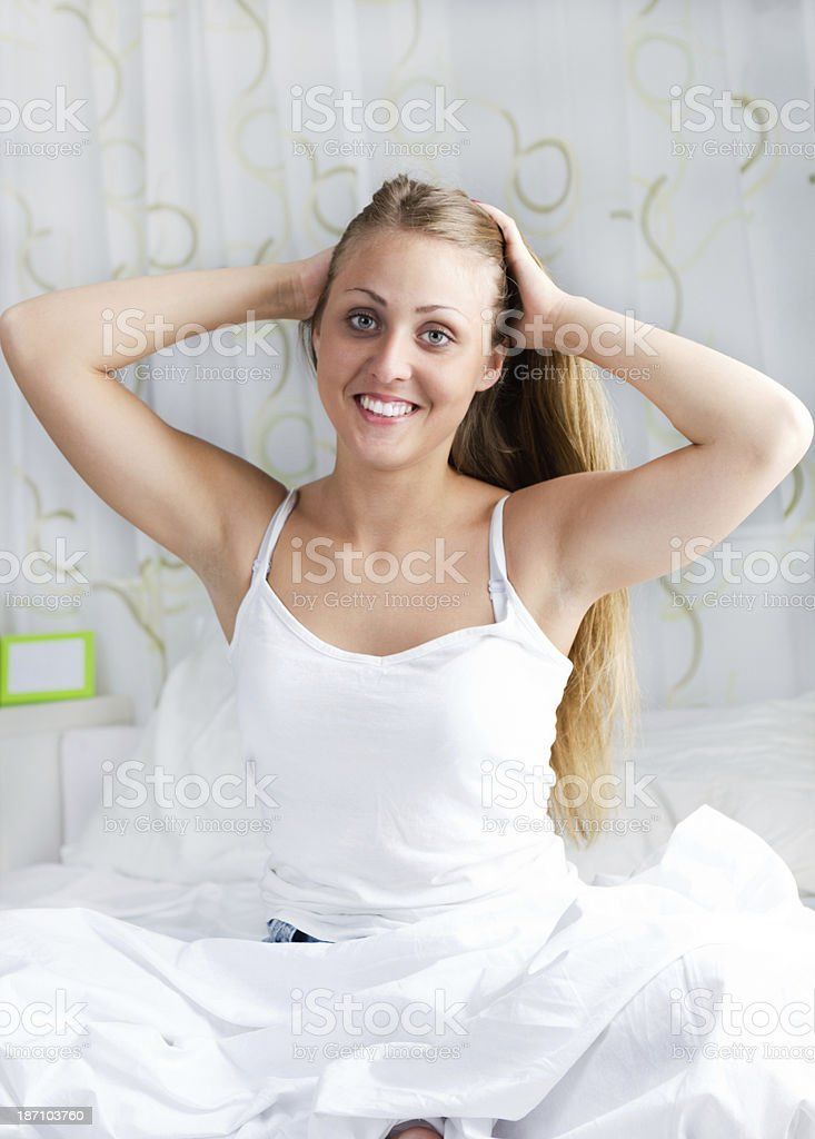 woman smiling in bed on the morning at home royalty-free stock photo