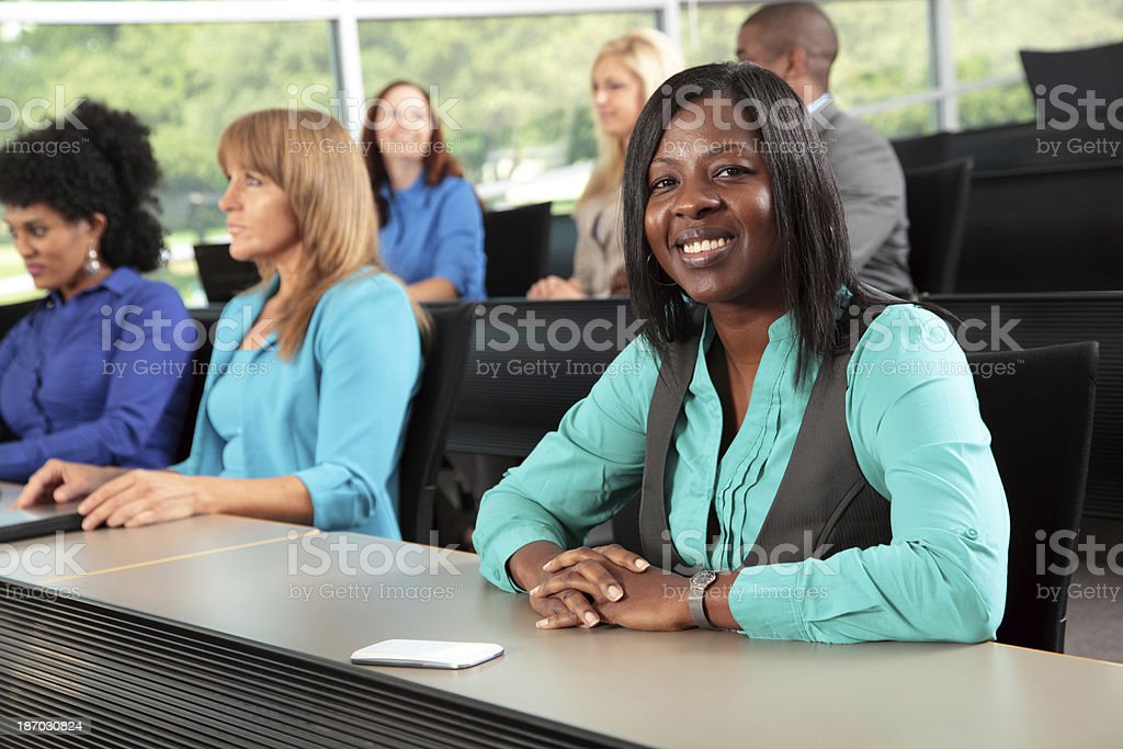 Woman smiling in lecture auditorium stock photo