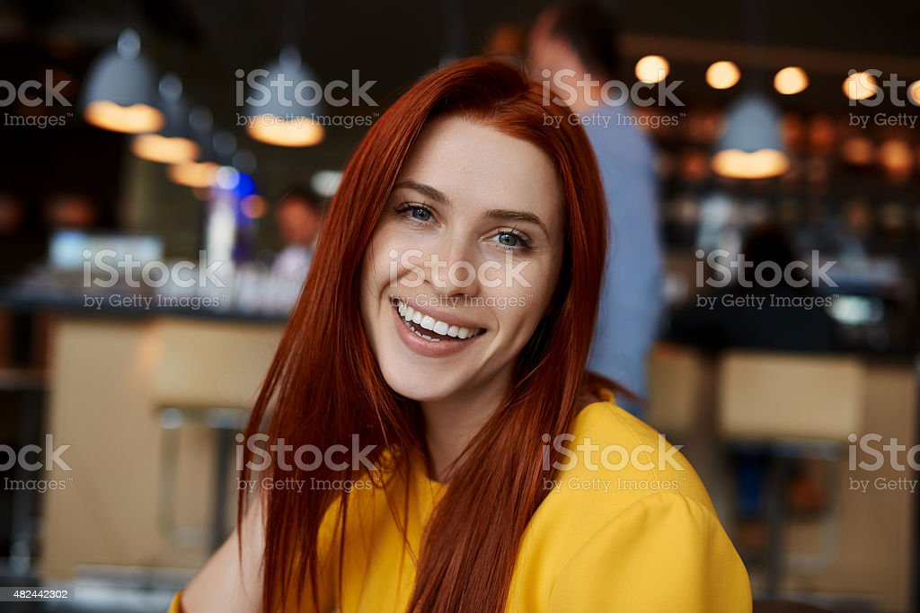 woman smiling in restaurant stock photo