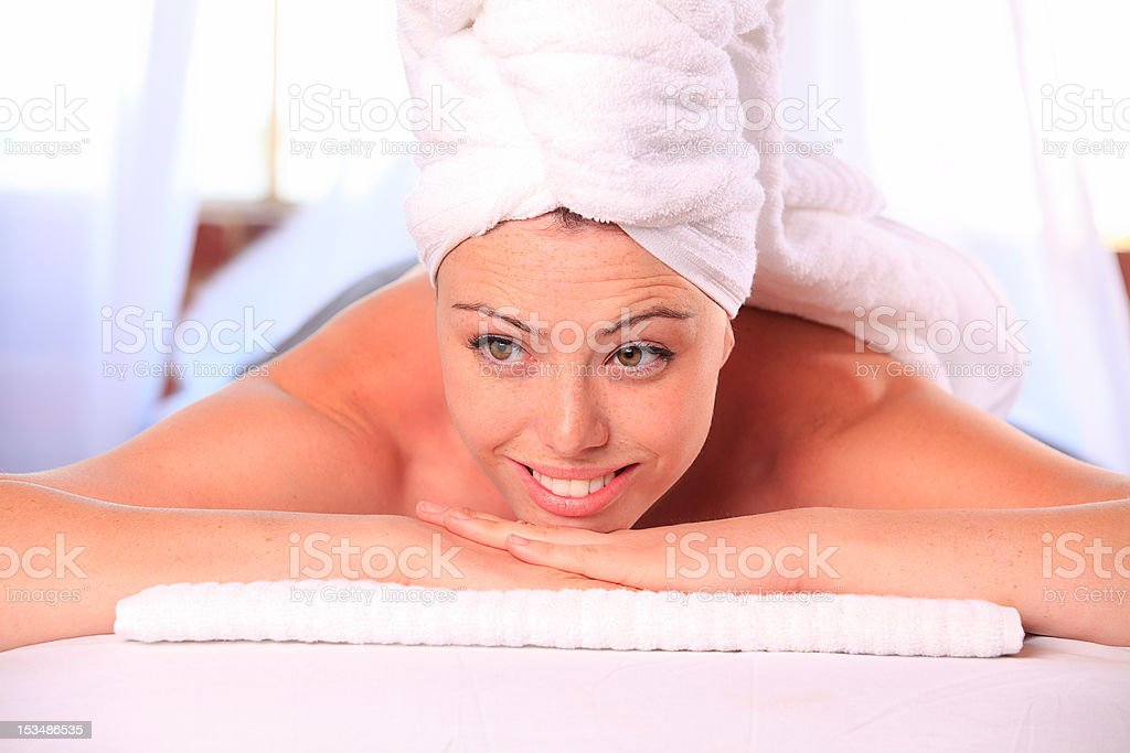 Woman smiling on massage table royalty-free stock photo