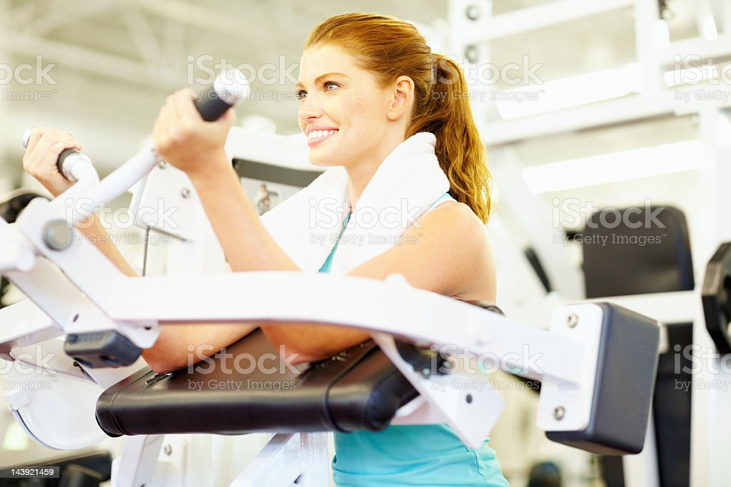 Woman smiling while exercising royalty-free stock photo