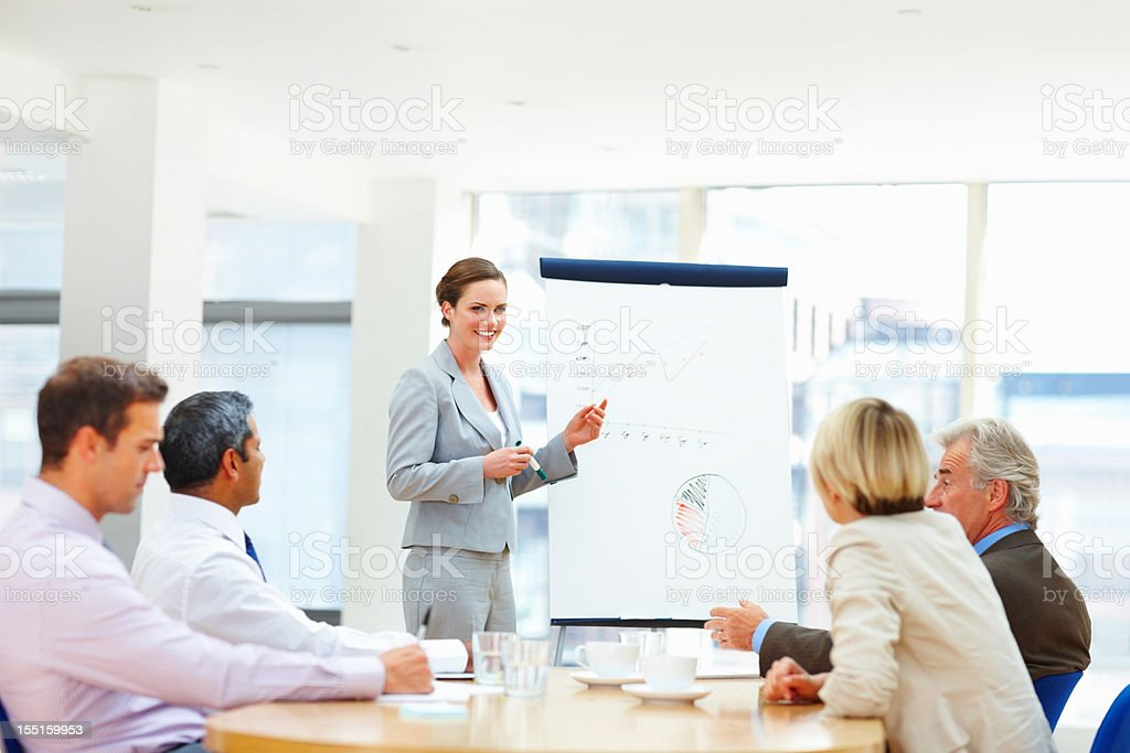 Woman smiling while giving a presentation royalty-free stock photo
