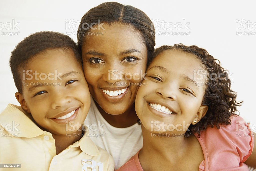 Woman smiling with her children royalty-free stock photo