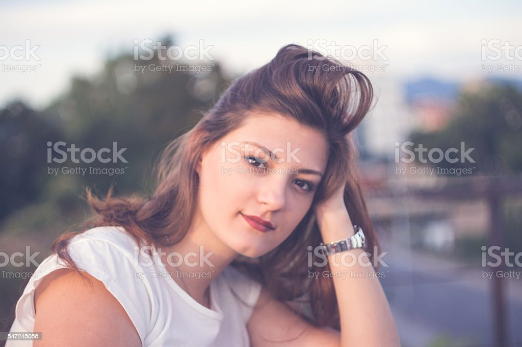 Woman smiling with perfect smile in a park stock photo