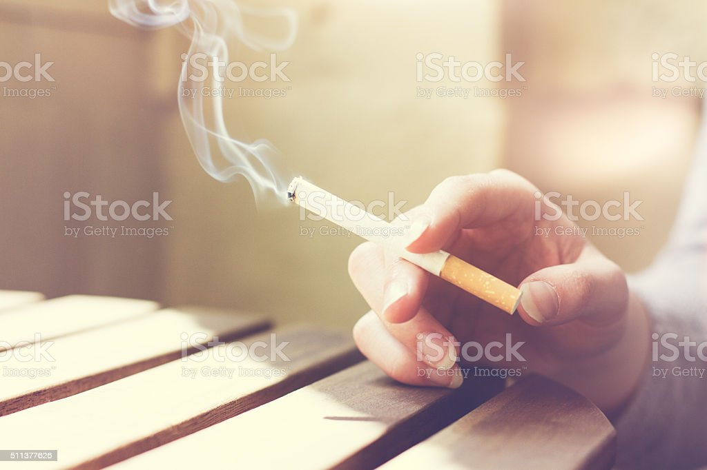 Woman smoker smoking a filter tip stock photo