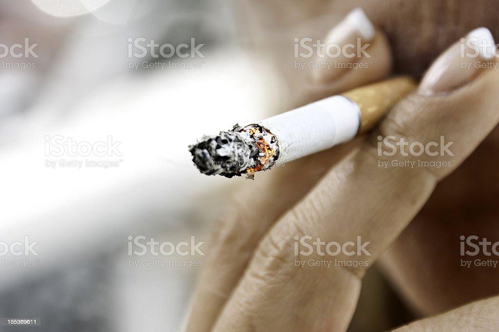 Woman smoking stock photo