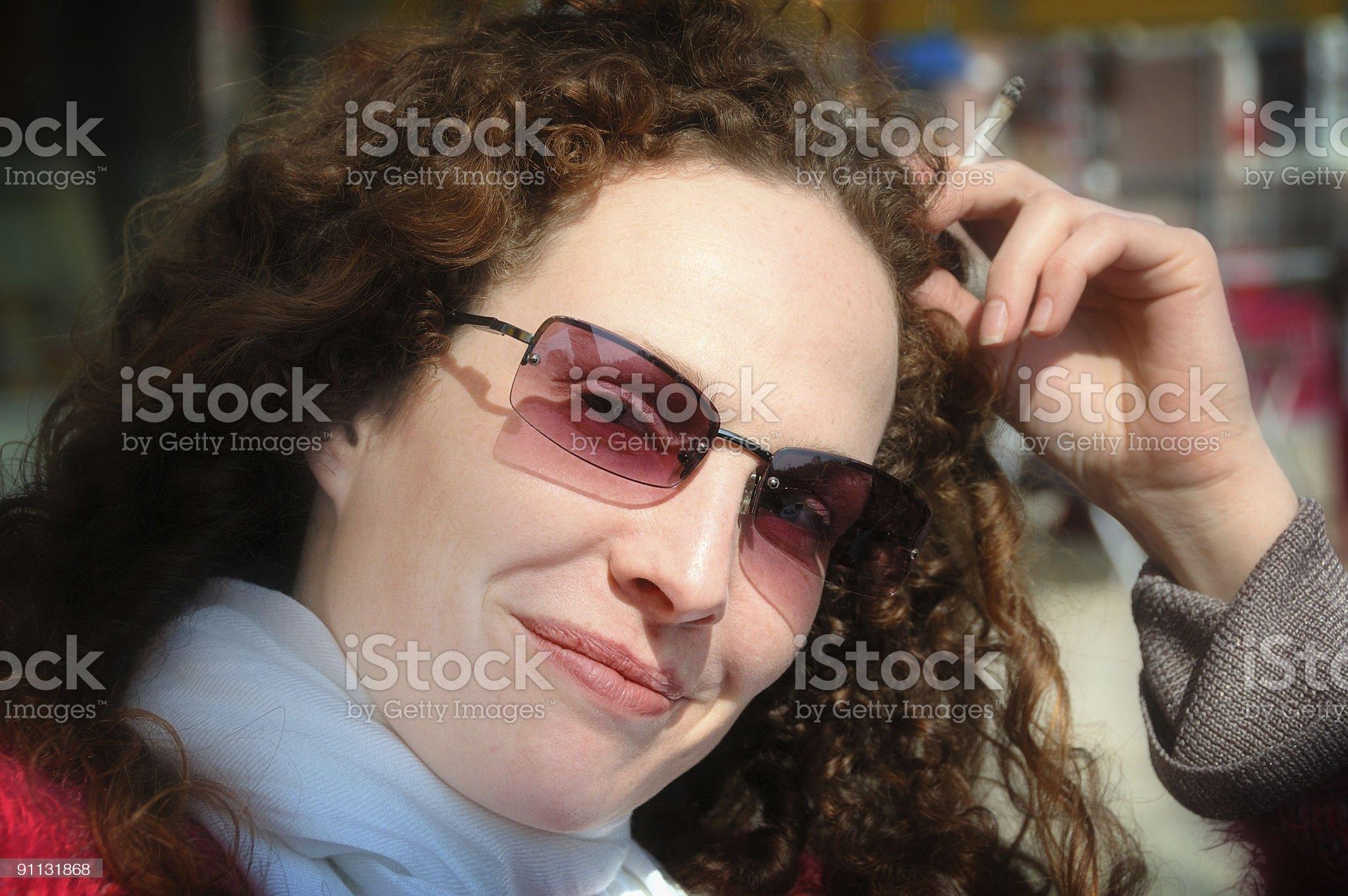 Woman smoking royalty-free stock photo