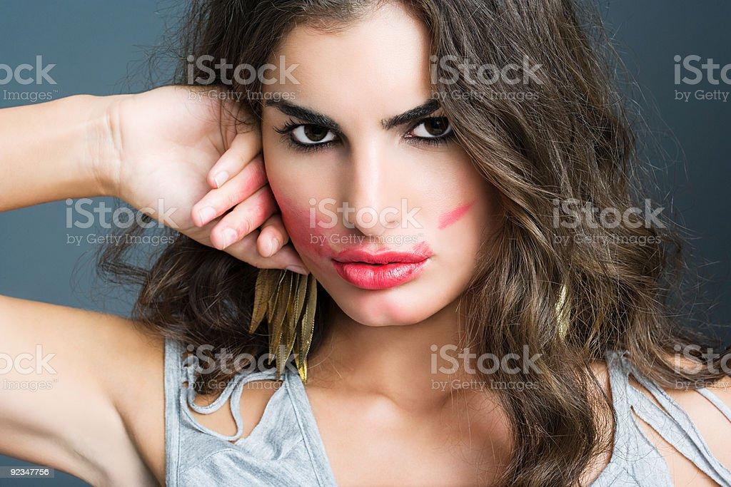 Woman smudging lipstick stock photo