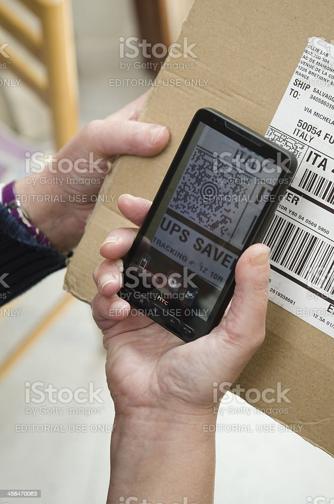 Woman snap picture of a QR code royalty-free stock photo