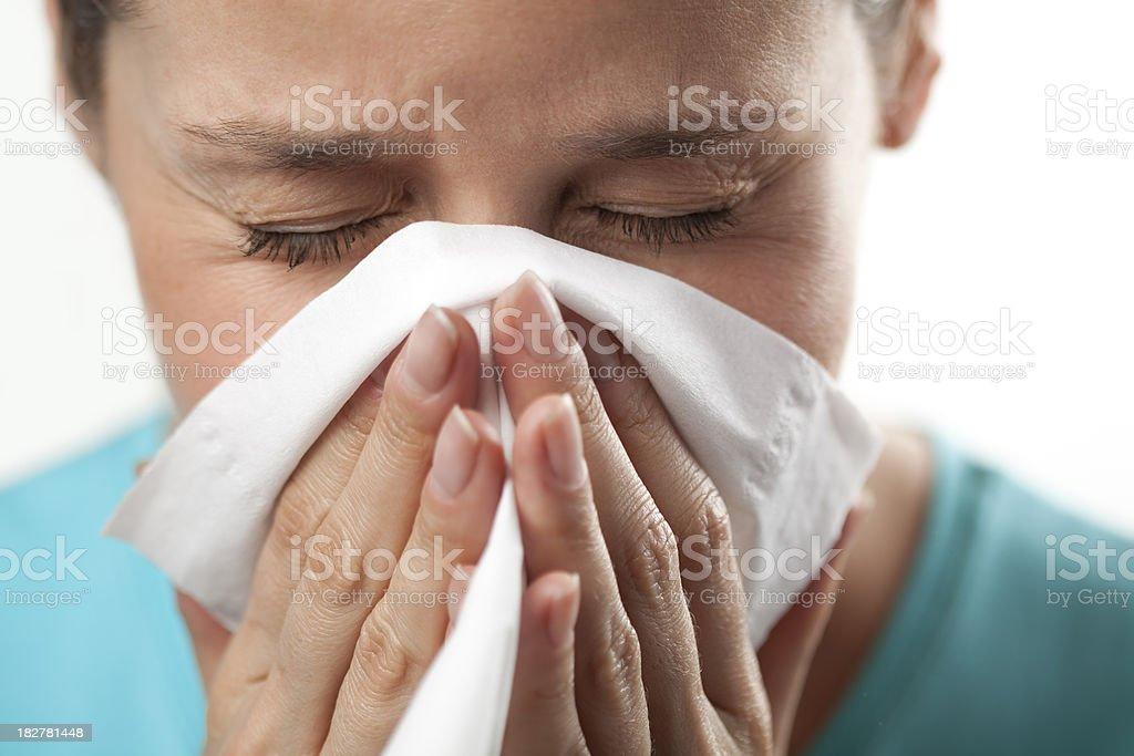 Woman sneezing close up royalty-free stock photo