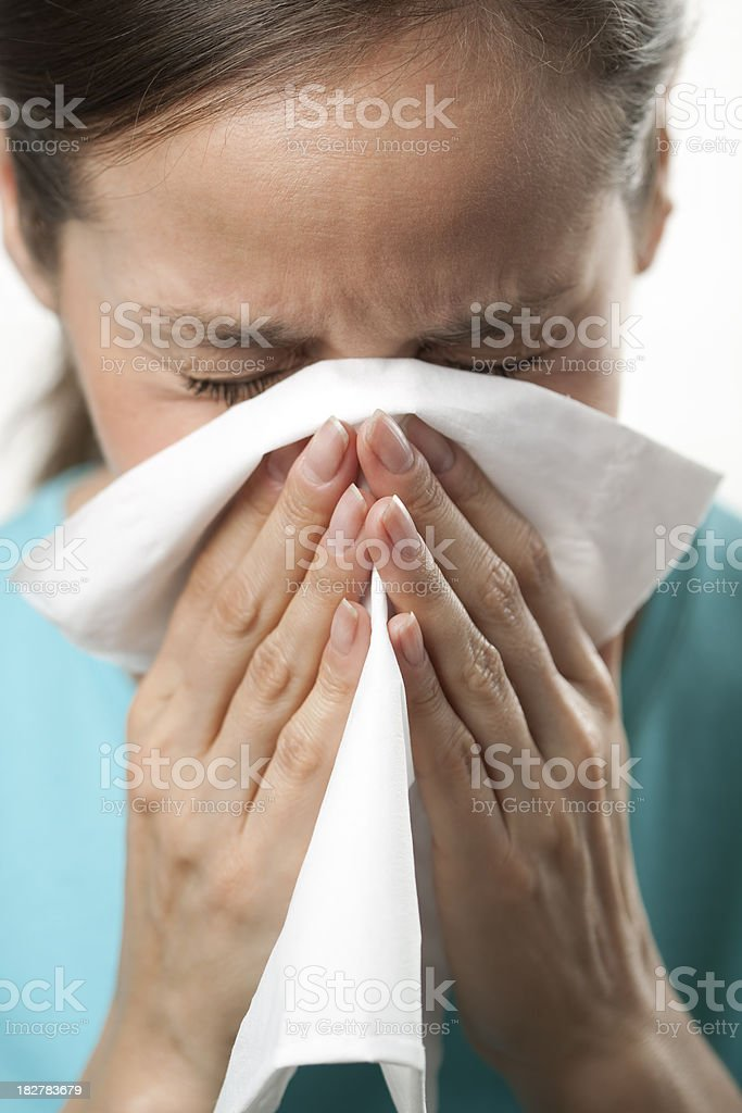 Woman sneezing or blowing nose royalty-free stock photo