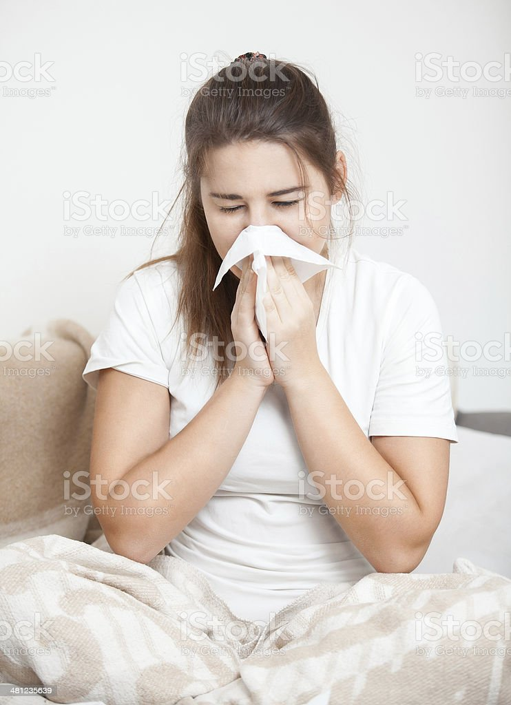 Woman sneezing royalty-free stock photo