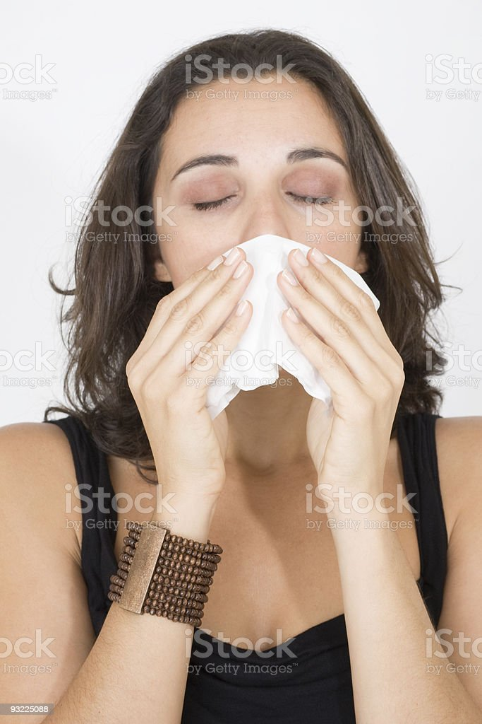 Woman Sneezing royalty-free stock photo