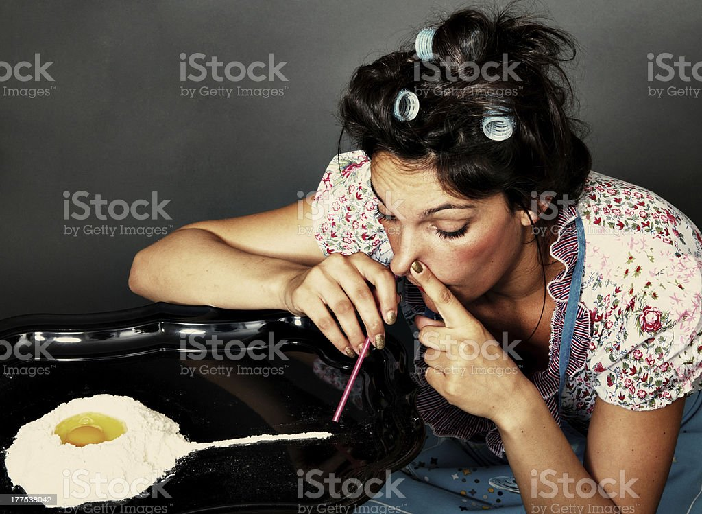 woman sniffing cocaine stock photo