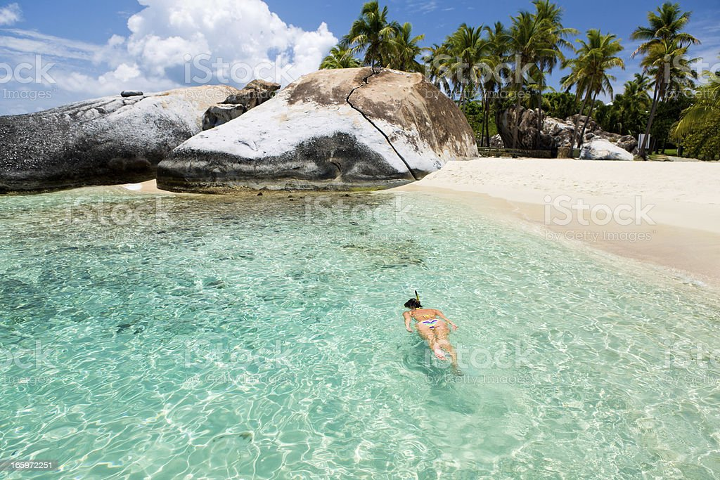 woman snorkeling at The Baths in Virgin Gorda, BVI stock photo
